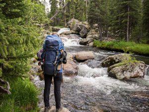 Cloud Peak Wilderness backpacker prepares to cross a stream