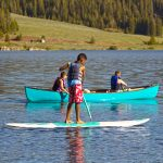 Meadowlark Lake paddleboarder in the Bighorn Mountains