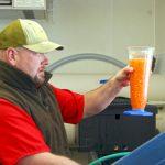 Fish Hatchery employee outside Ten Sleep, Wyoming